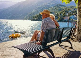 Couple sitting on bench at Ascona resort at Ticino Switzerland